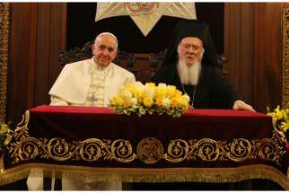 Pope Francis and Ecumenical Patriarch Bartholomew of Constantinople sit during signing of joint declaration at the patriarchal Church of St. George in Istanbul Nov. 30.