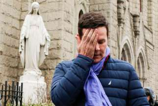 Juan Cruz becomes emotional after speaking to reporters Feb. 17 following a meeting with Archbishop Charles Scicluna of Malta, Italy, at the Church of the Holy Name of Jesus in New York City. Pope Francis asked Cardinal Scicluna to investigate allegations that Bishop Juan Barros of Osorno, Chile, covered up allegations of abuse committed by his former mentor, Father Fernando Karadima. Cruz, a victim of Father Karadima's now living in Philadelphia, had written to Pope Francis in 2015 claiming that then-Father Barros was present when some of the abuse took place.