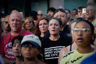 Mourners attend a vigil after a mass shooting in Dayton, Ohio, Aug. 4, 2019. Pope Francis joined other Catholic Church leaders expressing sorrow after back-to-back mass shootings in the United States left at least 31 dead and dozens injured in Texas and Ohio Aug. 3 and 4.