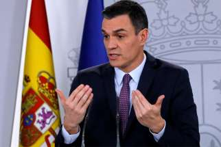 Spanish Prime Minister Pedro Sanchez gestures at a news conference after the first Cabinet meeting at Moncloa Palace in Madrid Jan. 14, 2020.