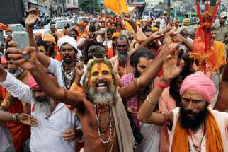 "Hindu holy men shout slogans and block a road during a protest against alleged violence against Hindus in Jammu, India, July 19. Leaders of the Pontifical Council for Interreligious Dialogue said Hindus and Christians must work for a ""culture of inclusio n for a just and peaceful society."""