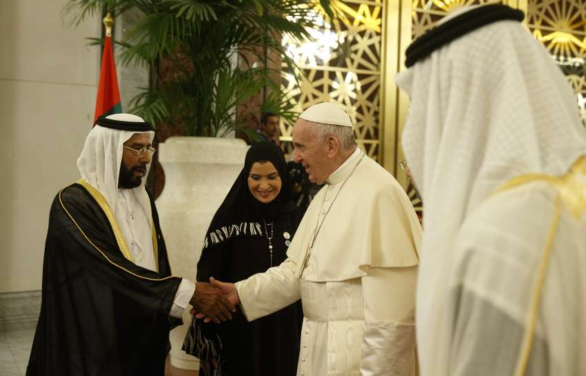 Pope Francis greets Sheikh Tahnoun bin Mohammed Al Nahyan, Abu Dhabi representative in the eastern region, upon his arrival at Abu Dhabi Presidential Flight airport in United Arab Emirates Feb. 3.