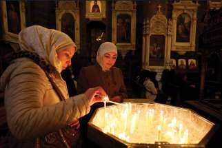 Christians light candles at Our Lady of Dormition Church in Damascus, Syria. Development and Peace wants the government to ensure a strong women's voice for peace in war-torn areas like Syria.