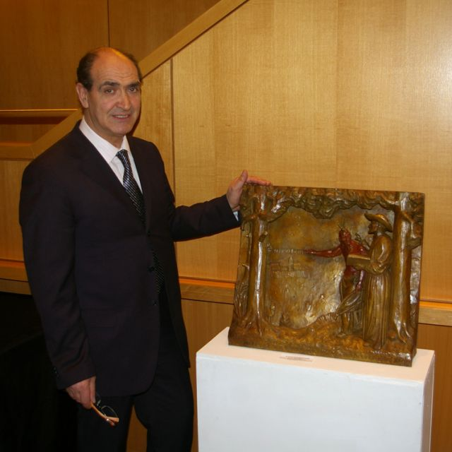 Antonio Caruso with his bronze carving of St. Jean de Brebeuf and Joseph Chihatenhwa. The piece is part of Caruso's exhibit running through the end of February at the Richmond Hill Centre for Performing Arts.