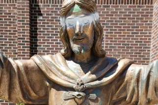 Vandals defaced a statue of Jesus outside Calgary's Sacred Heart Church in mid-July.