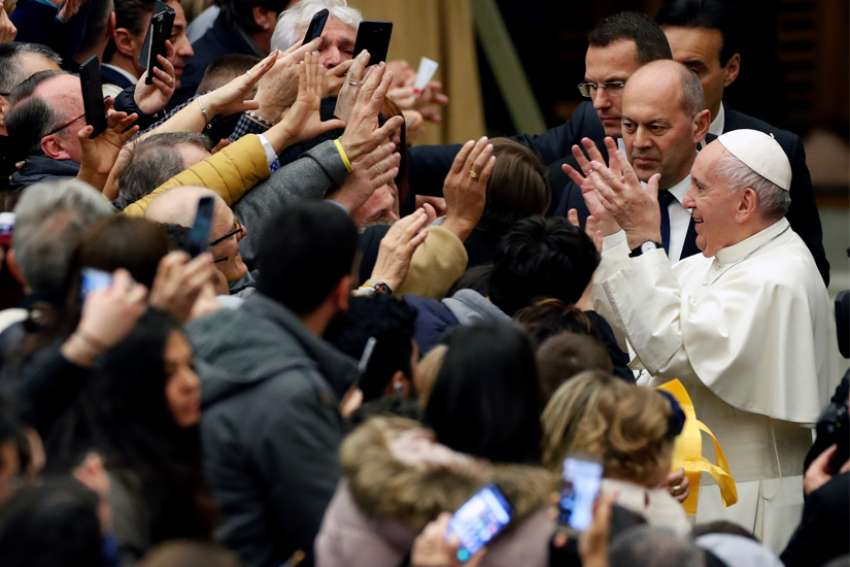 Pope Francis greets people as he arrives for his general audience in Paul VI hall at the Vatican Jan. 22, 2020.