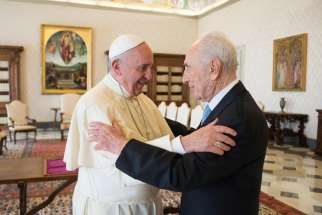 Pope Francis welcomes former Israeli President Shimon Peres in this photo dated 2012.
