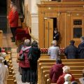 Parishioners wait in line for confession