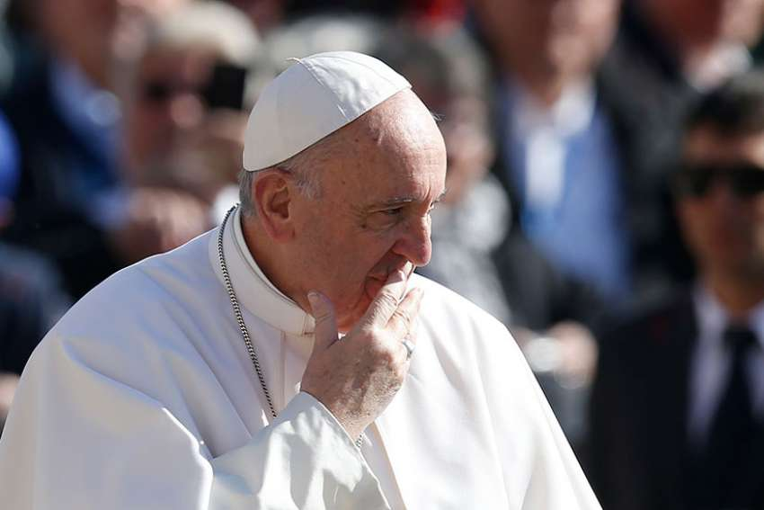 Pope Francis is pictured while greeting the crowd during his general audience in St. Peter's Square at the Vatican March 15.