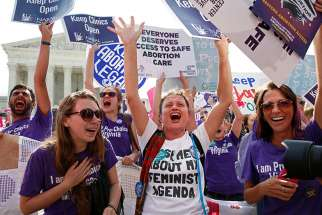 Demonstrators celebrate at the U.S. Supreme Court after the court struck down a Texas law imposing strict regulations on abortion doctors and facilities that its critics contended were specifically designed to shut down clinics in Washington on June 27, 2016.