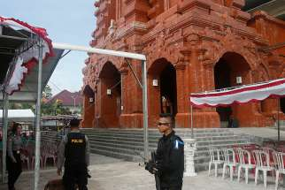 Indonesian police bomb squad members check a cathedral prior to the Christmas Eve Mass in 2016 in Bali. This year nearly 50,000 churches across Indonesia, including some previously attacked by terrorists, are to be guarded during the Christmas period.