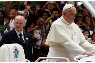 Pope Francis is expected to visit Ecuador, Bolivia and Paraguay this year. In this photo, Domenico Giani, commander of the Vatican police force, keeps watch as Pope Francis arrives to celebrate Mass in Manila, Philippines Jan. 16, 2015.