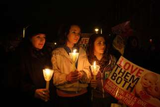 Young women hold candles as the gather for a pro-life vigil outside the Irish parliament in Dublin Jan. 19, 2013. An estimated 15,000 members of the Pro-Life Campaign came to Dublin May 3 to participate in the National Vigil for Life to work for the repeal of a controversial abortion law introduced in 2013.