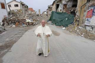 Pope Francis walks in the earthquake-ravaged town of Amatrice, Italy, Oct. 4. The town was devastated by an Aug. 24 earthquake that claimed the lives of nearly 300.