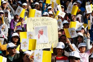 People wait for Pope Francis' arrival to celebrate Mass at Zayed Sports City Stadium in Abu Dhabi, United Arab Emirates, Feb. 5, 2019.