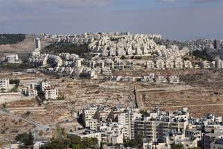 The Israeli settlement Har Homa is seen on the hillside overlooking houses in Bethlehem in the valley in the West Bank, in this Dec. 3, 2019, photo. Israeli Prime Minister Benjamin Netanyahu says he will annex Jewish settlements in the West Bank.