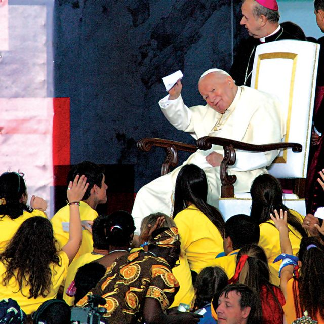 Pope John Paul II greets pilgrims at Downsview Park in Toronto in July 2002.