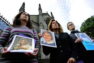 "Members of the U.S.-based Survivors Network of those Abused by Priests, or SNAP hold portraits of themselves as youths as they address the media during a protest outside St. Mary's Catholic Cathedral in Edinburgh, Scotland in this picture dated Sept. 15 2010.  The Survivors Network of those Abused by Priests, which represents 18,000 victims, said that hundreds of children and adults were still being ""sexually violated, tortured and assaulted"" by Catholic priests."