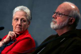 Irish abuse victim Marie Collins, the lone clerical abuse survivor nominated by Pope Francis to sit on the new Pontifical Commission for the Protection of Minors, looks at Boston Cardinal Sean P. O'Malley during their first briefing at the Holy See press office at the Vatican May 3. The papal commission will be expanding its nine-member panel to include more experts and another survivor of clerical abuse.