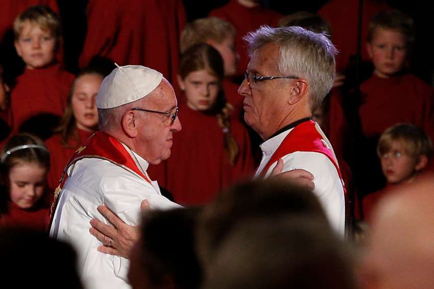 Pope Francis embraces the Rev. Martin Junge, general secretary of the Lutheran World Federation, during an ecumenical prayer service at the Lutheran cathedral in Lund, Sweden, Oct. 31, 2016.