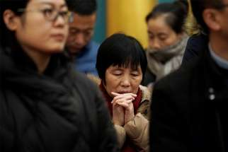 Chinese Catholics pray during Christmas Eve Mass at the Church of St. Saviour in Beijing.