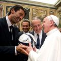 Pope Francis receives a soccer ball as gift from Italy's goalkeeper and captain, Gianluigi Buffon, during a private audience at the Vatican Aug. 13. Argentina will play Italy in a friendly soccer match Aug. 14 in the pope's honor.