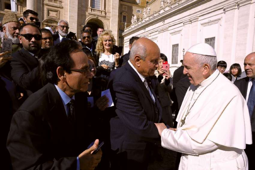 The Pope greets Mobeen Khaja and his delegation from the Association of Progressive Muslims of Canada, including several Catholics, in St. Peter's Square Oct. 24.