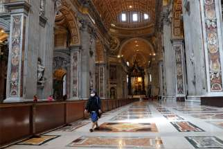 A nun walks in St. Peter's Basilica at the Vatican May 18, 2020, after the basilica reopened to the public during the COVID-19 pandemic.