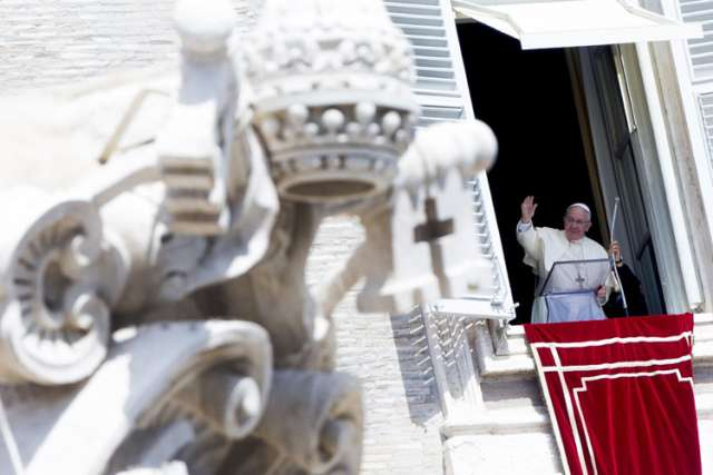 Pope Francis is pictured during his weekly Angelus prayer Aug. 24 from the window of his office in St. Peter's Square at the Vatican. The pope prayed for peace and marked Ukrainian Independence Day.