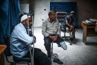 Syrian men who lost limbs during the civil war get prosthetic legs in Hamorya, Syria, in this Oct. 22, 2015, file photo.
