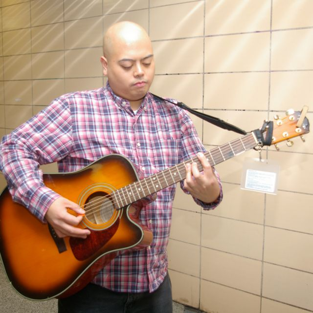 "Benjamin ""Lex"" Tan shares his talents with people making the daily commute on Toronto's subway system. Tan is one of 74 musicians who auditioned for the busker position to entertain Toronto commuters."