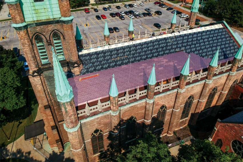New copper shingles are being installed at Our Lady of Assumption Church, part of the first phase of renovations in the 177-year-old church in Windsor, Ont.