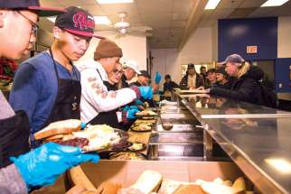 Volunteers serve Christmas dinner at Toronto's Good Shepherd Ministries