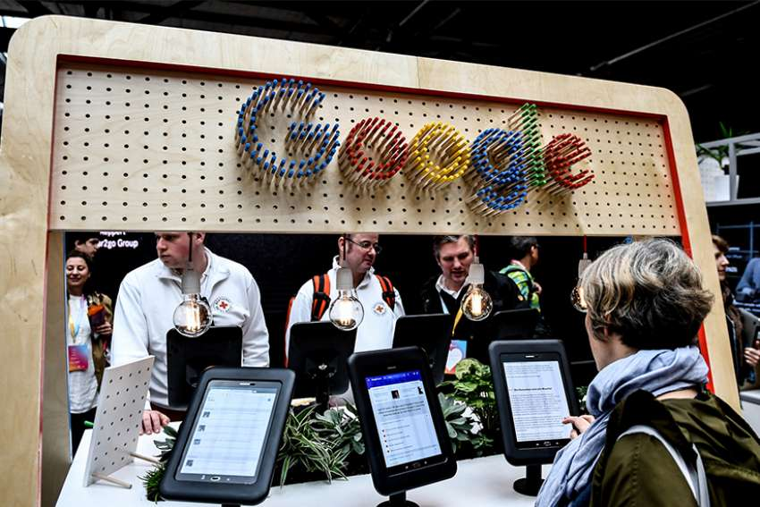 Visitors look at the digital media offerings at the booth of technology giant Google at the Republica 17 digital conference May 8, 2017, in Berlin. In an age when technology is ever-evolving, Catholic news organizations must be willing to adapt to effectively proclaim the Gospel to all, Pope Francis said.