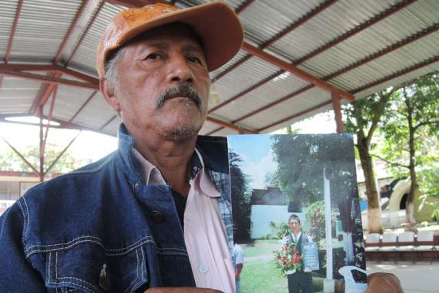 Margarito Ramirez shows a picture of his 20-year-old son, Carlos Ivan Ramirez Villarreal, Oct. 8, who was among the 43 students missing in Mexico's Guerrero state. The Sept. 26 disappearance of so many students in Guerrero states has sparked internationa l outrage and soul searching among many Mexicans.