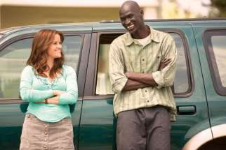 Ger Duany (right) as Sudanese refugee Jeremiah who adjusts to American life with the help of employment agency counsellor Carrie played by Reese Witherspoon