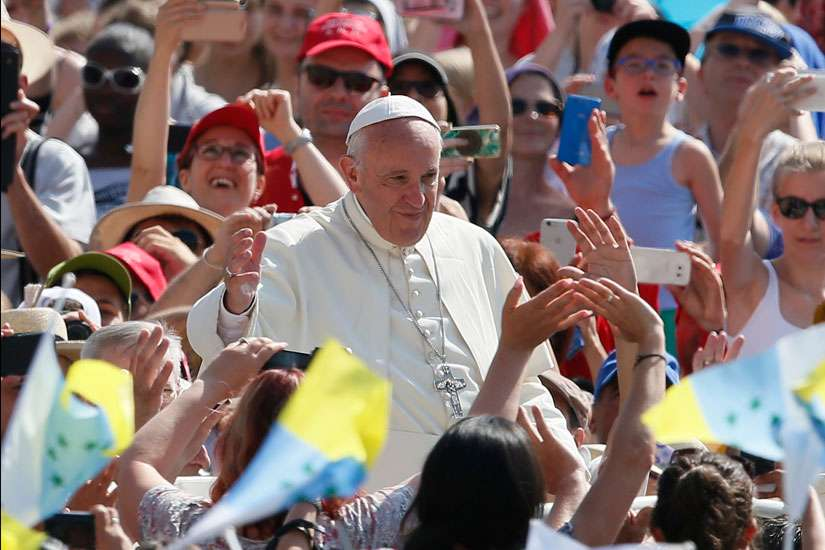 Pope Francis greets the crowd during a jubilee audience in St. Peter's Square at the Vatican June 30. The Pope is asking World Youth Day pilgrims to accompany his visit with prayer.