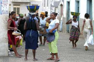 Women are seen near a market in Praia, Cape Verde, in this 2004 file photo. The African nation of half a million people has 7,500 confirmed cases of the Zika virus, but health officials suspect more cases are unreported.