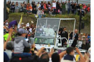 Pope Francis greets the crowd from his popemobile, a Jeep Wrangler, as he arrives in Quito, Ecuador, July 5. The pontiff will use the same model during his visit to the United States in September.