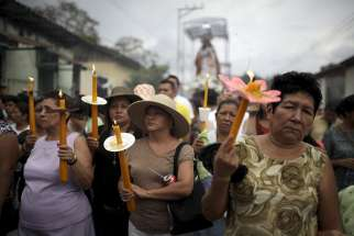 Worshippers carry candles April 2 as they participate in a Via Crucis (Way of the Cross) procession as part of Holy Week celebrations in the town of Izalco, El Salvador.