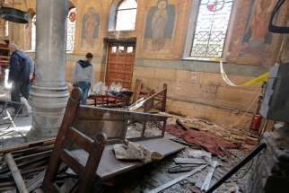 Egyptian security officials and investigators inspect the scene following a bombing inside Cairo's Coptic cathedral in Egypt December 11, 2016.