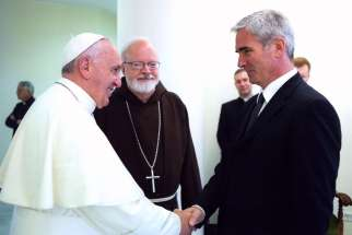 Pope Francis shakes hands with a clerical abuse survivor at the Vatican on July 7, 2014. The Pope said that there is no place in ministry for those who abuse minors, in a written letter dated Feb 2, to bishops and religious orders.