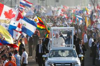 Pope Francis greets the crowd before celebrating Mass for World Youth Day pilgrims at St. John Paul II Field in Panama City Jan. 27, 2019.