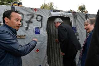Cardinal Konrad Krajewski, papal almoner, enters a tent in the informal Moria refugee camp on the Greek island of Lesbos May 8, 2019.