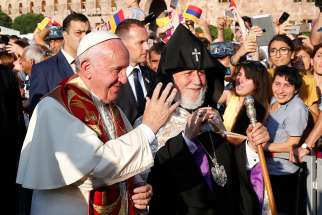 Pope Francis and Catholicos Karekin II, patriarch of the Armenian Apostolic Church, arrive for an ecumenical meeting and prayer for peace in Republic Square in Yerevan, Armenia, June 25.