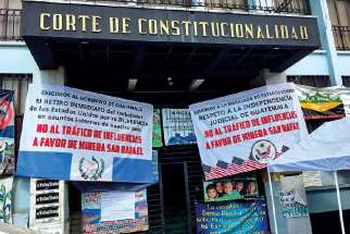 "In addition to their vigil outside the gates of Canadian-owned Escobal Mine, Xinka protesters maintained a presence outside Guatemala's Supreme court in advance of the court's September decision to confirm suspension of the mine's licence. The signs read, ""No to influence trading on behalf of San Rafael Mining."""
