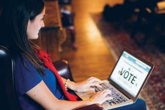 Daniela De Ciantis researches candidates before Toronto's municipal elections to be held Oct. 27.