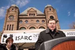 Bishop Wayne Kirkpatrick, as part of the Interfaith Social Assistance Reform Coalition, gathered in front of Queen's Park April 5 to pray for each of the 107 MPPs in hope of a budget that will help the poor.