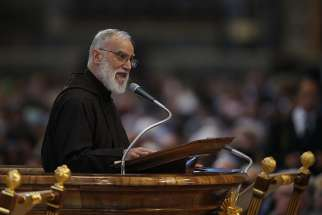 Capuchin Franciscan Father Raniero Cantalamessa, preacher of the papal household, gives the homily during the Good Friday service led by Pope Francis in St. Peter's Basilica at the Vatican April 14.