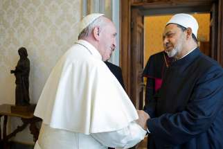 Pope Francis greets Ahmad el-Tayeb, grand imam of Egypt's al-Azhar mosque and university, during a private meeting at the Vatican May 23. The Vatican and Al-Azhar is teaming up to combat religious justification for violence.